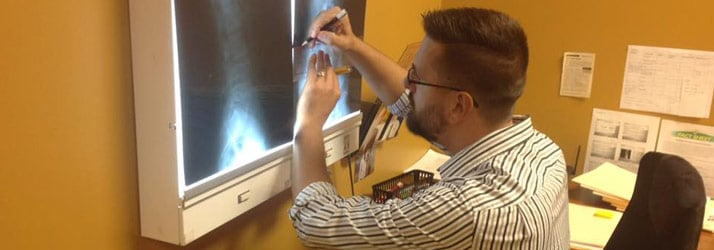 Chiropractor Chattanooga TN Davy Addison analyzing an x-ray